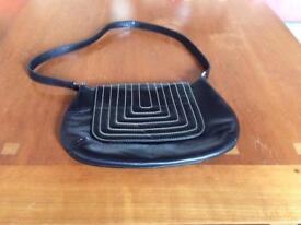 Black leather handbag with white stitching