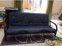 Metal sprung double futon. Black frame with Navy cushion. Few marks