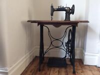 Old Sewing Machine with wood table