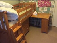 Pine Cabin bed with pull out desk, shelf, cupboard and drawers.