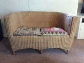 Stylish 2 seater wicker sofa with cushions