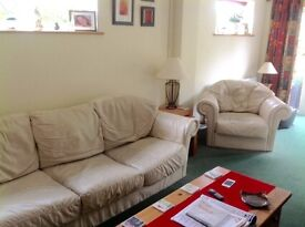 Cream leather 3 seater and two armchairs
