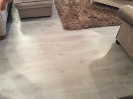 White laminate wooden flooring 25 square metre's