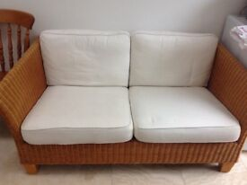 Two Rattan Couches with Off-White Cushions - all proceeds to charity