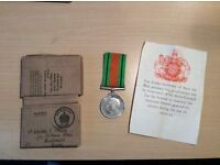 World War II Defence Medal with ribbon, certificate and original delivery box.