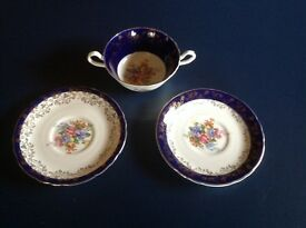 Two Aynsley Saucers and matching two handled cup