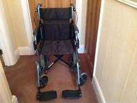 WHEELCHAIR WITH SEAT CUSHION AND REMOVABLE SHOPPING BAG