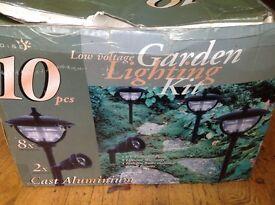 Garden lights. 8 lanterns and 2 spotlights still boxed.