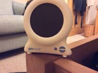 Gro clock with mains adaptor and instruction booklet.