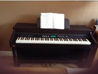 Digital Piano for sale. LCD Graphic display. 99 Accompaniment styles and many other features.