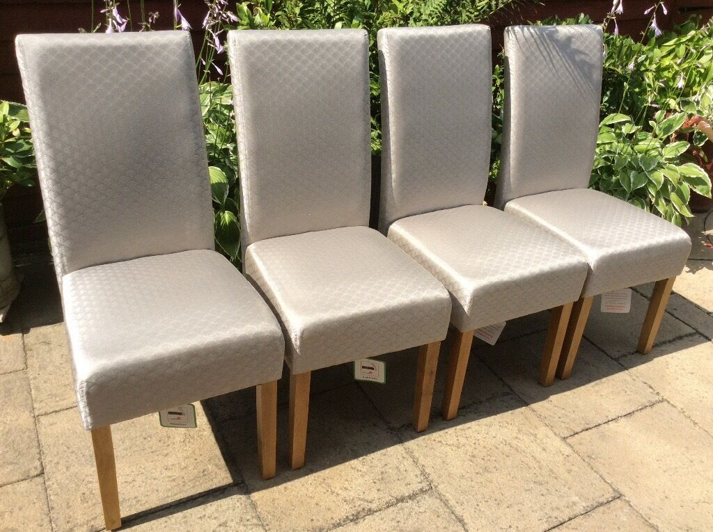 MS Dining Chairs x 4New With Tagsin Carlton, NottinghamshireGumtree - Dining Chairs x Four M & S Great Quality Colour Silver Grey Pattened Solid Oak Legs Possible Local Delivery