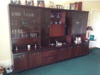 Beautiful dark rosewood wall cabinet with glass front for displaying ornaments