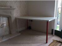 White Ikea desk/table. Excellent condition with 2 white and 2 red removable legs.