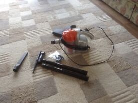 Quest vacuum cleaner, lightweight and comes with all attachments. Hardly used.