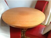Round extendable dining table