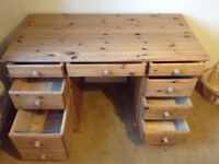 Sturdy Pine desk. Eight drawers, one a double. Dimensions 64cm deep, 120 cm wide, 74cm high.