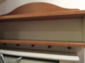 Back to wall shelf unit with coat hangers