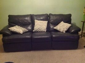Leather reclining sofa, good condition, Air Force blue leather with reclining seat at each end