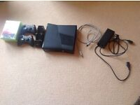 Xbox 360 + box with two controllers and rechargable battery packs + 5 games