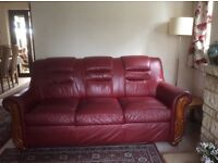 3 seater red leather sofa needing a home. The sofa is three years old and in very good condition.