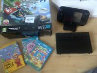 Wii u console and games (boxed)