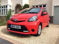 2014 Toyota Aygo in Chilli Red. 5 door hatchback. Low mileage. Fantastic condition including Sat Nav