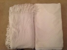 Two white cotton double bedspreads