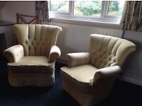 Two arm chairs pale yellow button back.