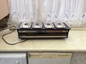 Heated hostess tray. Four glass serving dishes. Beautiful dinner plates included.