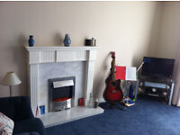 Wall mounted fire place and fire like know cheap and Three seater couch and chair free