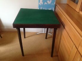 "Card table. Folding card table 60cm x 60cm x 65cm or 2' x 2' x2' 2"" average condition"