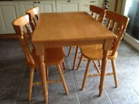 Pine dining / kitchin table and four matching chairs, excellent condition