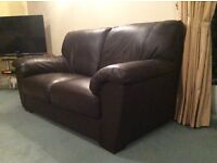 Nearly new brown soft leather sofa