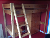 Solid pine high sleeper bed with underneath desk and wardrobe