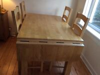 Solid wood extendable table and six chairs.