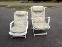 2 white garden loungers with cushions