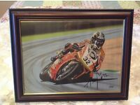 A framed painting of Troy Baylis.