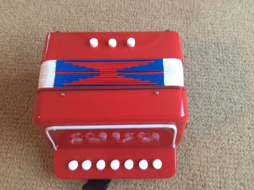 Tobar Toy Accordion new in box with instructions.
