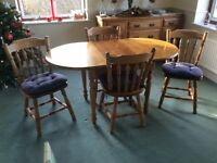 Table, extending to 1.34m, and 4 chairs, pine, including blue cushions