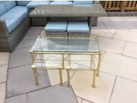 Glass coffee table with a nest of two tables with a brass surround