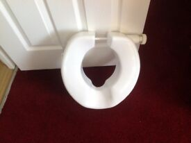 As new raised toilet seat