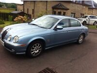 Nice Jag with a bashed door, might swap for something interesting