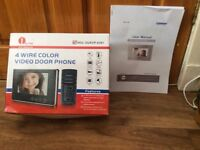 Brand new (in box) 4 wire colour video door phone by 1 by one, complete with user manual.