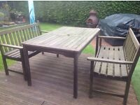 Wooden table with bench chairs