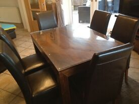 Dark wood Mango dining table and 6 chairs