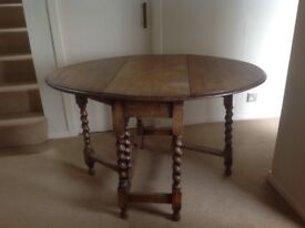 Solid oak gate leg table 120cm X 90 cm. Barley twist legs.