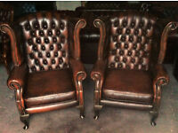 Pair of brown leather Chesterfield Wing back chairs