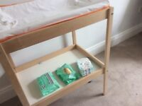 Ikea beech cot and changing table for sale. Includes mattress. Sniglar model