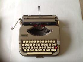 Vintage/antique portable manual typewriter by Scheideggar