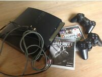 Sony PlayStation 3 with 2 games, 2 controllers and leads